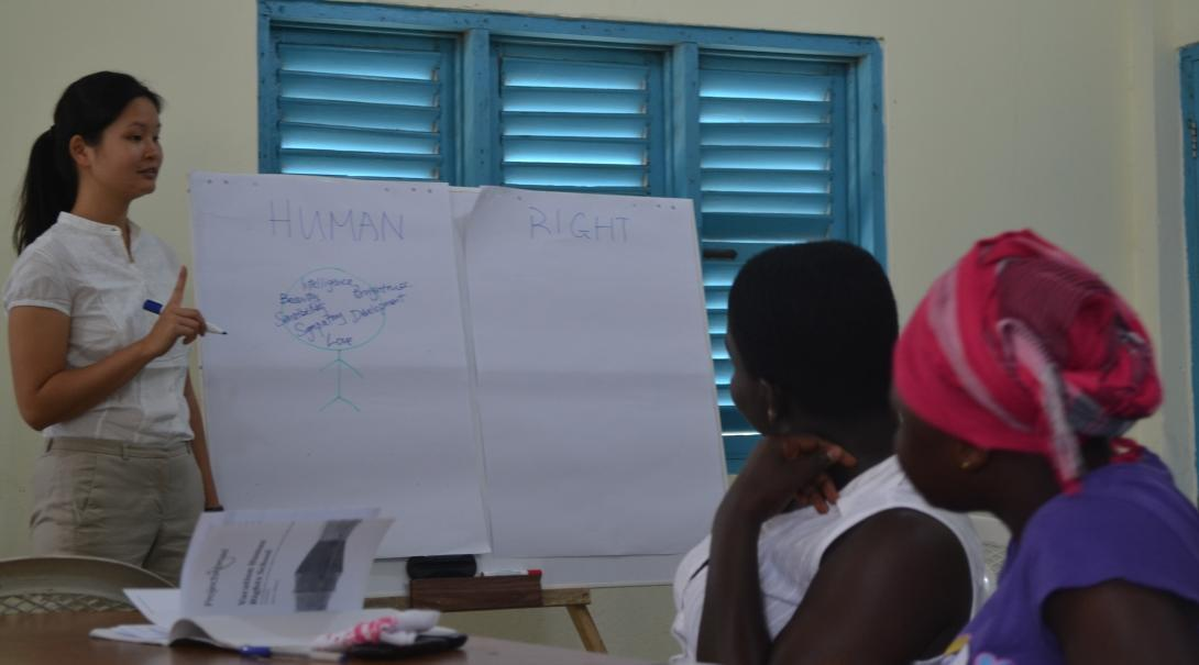 A student addresses woman during her Law internships in Ghana.